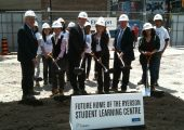 Ryerson University students, staff and government officials took part in the official groundbreaking ceremony for the school's new 155,463 sq. ft. Student Learning Centre in downtown Toronto on May 30, 2012. From left: Sheldon Levy, president, Ryerson University; Coun. Kristyn Wong-Tam; Alan Shepard; Julia Hanigsberg; Kevin Flynn, parliamentary secretary and Minister of Training, Colleges and Universities; and Marwa Hamad (Ryerson University students in background).