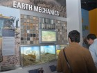 Trade press stop to check out an exhibit on earth mechanics. Staff photo.