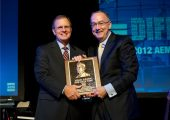 Deere & Company chairman and CEO Sam Allen accepts the AEM Hall of Fame plaque from 2012 chair of the AEM and CEO of Krone, North America, Rusty Fowler.