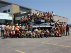 Clark Builders employees take a photo at the site for Edmonton's new Police Services Station during a company barbecue held last summer. Clark's management arranged for EPS to bring out their new tank during the event. Photo courtesy of Clark Builders.