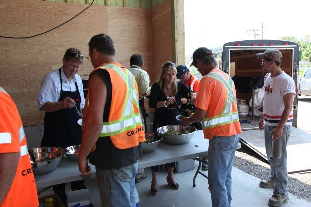 Senior management at Cruickshank Group Inc. feed their crew during one of the company's Roadkill Barbecues, which are held approximately 14 times a year. Senior management take a trailer with a barbecue to all the Cruickshank job sites and cook up a steak dinner for every employee. Photo courtesy of Cruickshank Group.