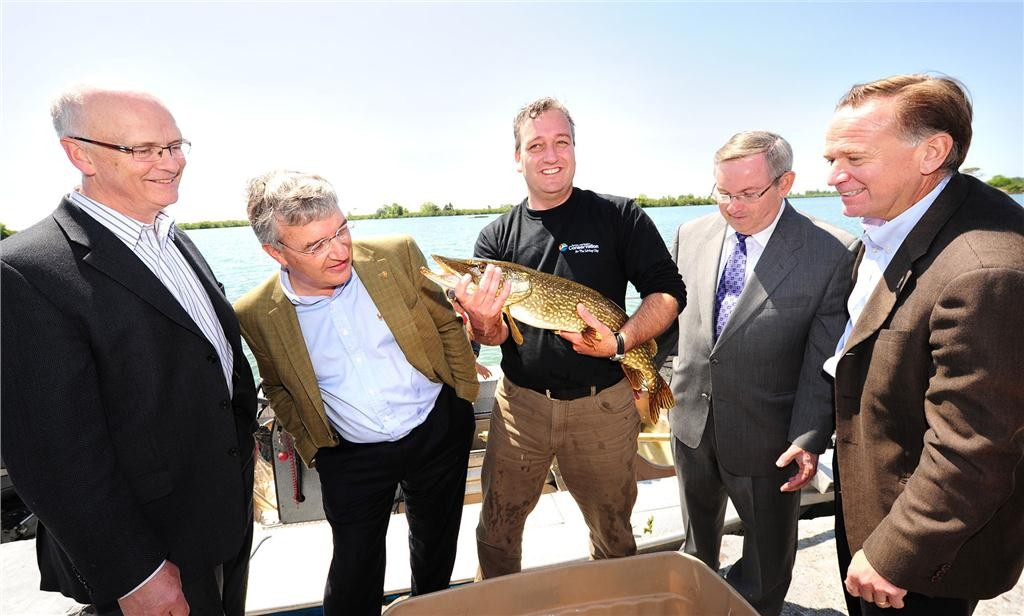 Brian Denney, CEO of Toronto and Region Conservation, Nicola Kettlitz, President, Coca-Cola Ltd., Rick Portiss, Manager, Restoration and Environmental Monitoring, Toronto and Region Conservation, Hon. Jim Bradley, Minister of the Environment, Government of Ontario and John Guarino, President, Coca-Cola Refreshments Canada with their big catch at Tommy Thompson Park on the Leslie Street Spit. Toronto and Region Conservation and Coca-Cola Canada have partnered to restore nine hectares of the Park into a flourishing coastal wetland. CNW