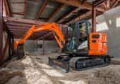 Reduced tail swing excavators
