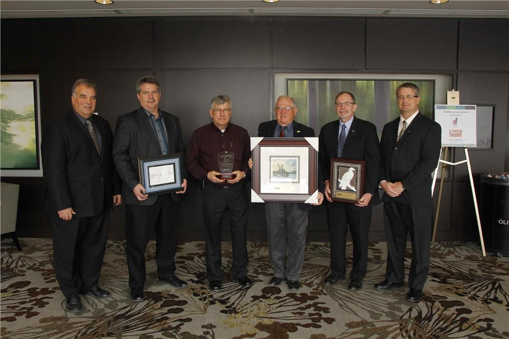 From left: OHMPA president Bentley Eghoetz, vice-president of FLO Compenents Mike Deckert, Fowler Construction foreman and supervisor Roger Brassard, senior advisor for Bitumar Laverne Miller, Murray Group Ltd. general manager Murray Ritchie, OHMPA past president Collin Burpee.