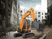 Nimble excavator for tight spaces
