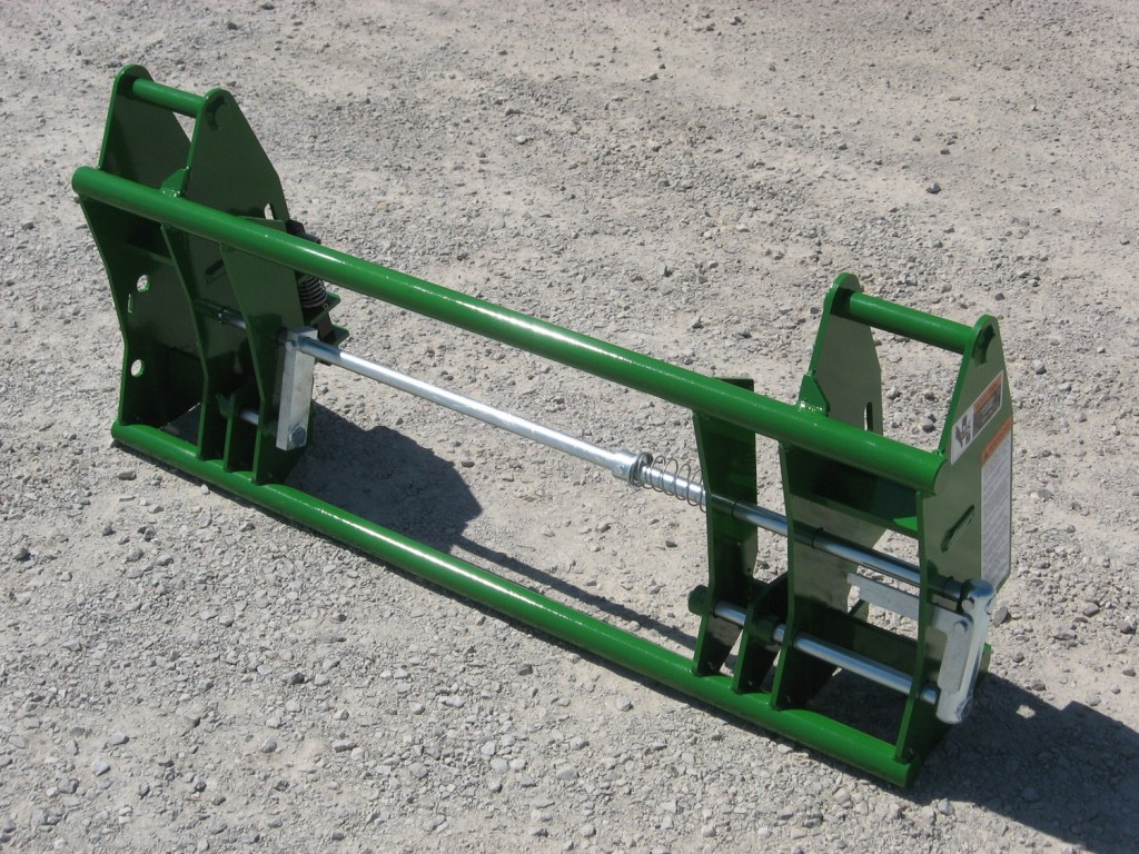 Attachment adapter for John Deere loaders
