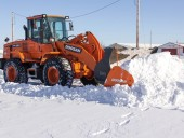 Doosan's new bucket-mounted snow pushers.