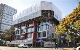 Upbrella Construction is using a unique system that sees the roof of a 10-storey condominium project being built first.