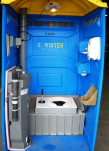 """Portable """"Sure- Flush"""" toilets with warm water sink cleanup faculties and electric fan heater mounted on the wall or a infrared heat lamp mounted in the ceiling."""