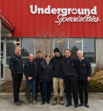 PHOTO CAPTION: Brian Scott, Wolseley Canada's Ontario waterworks general manager (second from right), poses with employees from Underground Specialties Inc.'s location in Cambridge, Ont. On March 1, Wolseley Canada Inc. acquired Underground Specialties Inc.