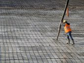 Construction site concrete casting on Reinforcing Bar of industrial floor