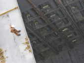 man working over precipice – risk of falling