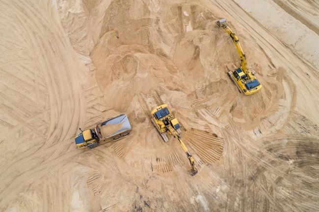 job_site_equipment_excavator_truck_aerial_dirt_sand