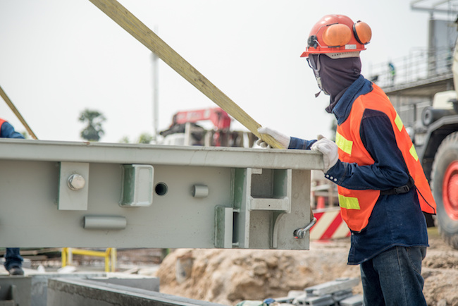 construction worker in stall truck scale structure in construction site safety uniform