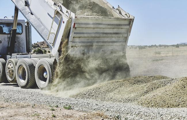 Dump Truck dumping Gravel on Driveway